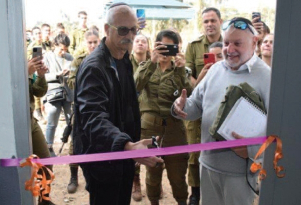Graham Nussbaum, Chairman of Young Israel Synagogue, North Netanya, cuts the ribbon watched by Ian Fine, Chairman of the English-speaking branch of AWIS in Israel